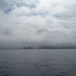Onderweg naar La Coruña. Bewolking op het land op het water zon